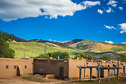Taos Pueblo (or Pueblo de Taos) is an ancient pueblo belonging to a Tiwa-speaking Native American tribe of Puebloan people. It lies about 1 mile north of the modern city of Taos, New Mexico, USA. The pueblos are considered to be one of the oldest continuously inhabited communities in the United States. This has been designated a UNESCO World Heritage Site.<br /> <br /> Taos Pueblo is a member of the Eight Northern Pueblos, whose people speak two variants of the Tanoan language. The Taos community is known for being one of the most private, secretive, and conservative pueblos. A reservation of 95,000 acres is attached to the pueblo, and about 4,500 people live in this area.
