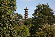 View of the Great Pagoda at Kew Gardens in London, United Kingdom. The Royal Botanic Gardens, Kew, usually referred to simply as Kew Gardens, are 121 hectares of botanical gardens and glasshouses between Richmond and Kew in southwest London. It is an internationally important botanical research and education institution with 700 staff, receiving around 2 million visitors per year. Its living collections include more than 30,000 different kinds of plants.