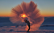 Amazing shot of frozen tea<br /> <br /> Canadian photographer, Michael Davies, has shown us a reminder as to how beautiful winter can be with his latest photo Tossing Tea on the Tundraí. Davies, who lives in Canada's high arctic, drove his Ski-Doo 45 minutes to the top of a mountain with his camera, multiple thermoses of tea and friend Markus in tow. The air temperature was -25ó35 degrees Celsius (-13 degrees Fahrenheit) when Davies threw the hot tea into the freezing air, which resulted in an amazing photo.<br /> ìI almost always work in this temperature. In fact, you could say I specialise in them. When most photographers would deem the temperature too low, I generally am gearing up to go out for a shoot For 10 years I have been an avid photographer, documenting the landscape, animals and people here with my trusty Nikon products says Davies.<br /> ©Exclusivepix Media