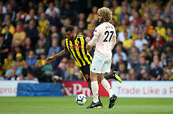 """Watford's Troy Deeney (left) and Manchester United's Marouane Fellaini battle for the ball during the Premier League match at Vicarage Road, Watford PRESS ASSOCIATION Photo. Picture date: Saturday September 15, 2018. See PA story SOCCER Watford. Photo credit should read: Nigel French/PA Wire. RESTRICTIONS: EDITORIAL USE ONLY No use with unauthorised audio, video, data, fixture lists, club/league logos or """"live"""" services. Online in-match use limited to 120 images, no video emulation. No use in betting, games or single club/league/player publications."""