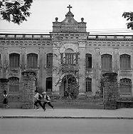 Students in front of an ancient Catholic french school in hue, Vietnam..2005