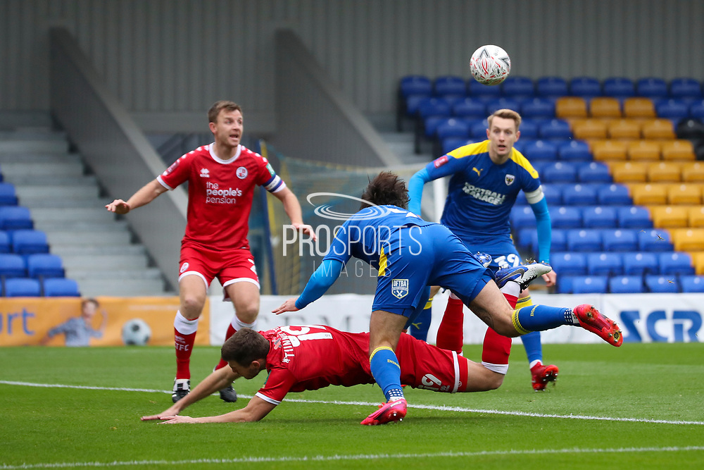 AFC Wimbledon striker Ollie Palmer (9) heading in the box and tryng tofind AFC Wimbledon striker Joe Pigott (39) during the The FA Cup match between AFC Wimbledon and Crawley Town at Plough Lane, London, United Kingdom on 29 November 2020.