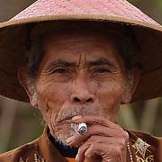 A portrait of Mr. Karto Prawiro, a duck farmer, in Java, Indonesia.