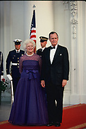 George HW and Barbara Bush wait for a White House State Dinner <br />Photo by Dennis Brack