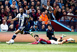 Aston Villa's Jack Grealish (right) on the floor after a battle for the ball with West Bromwich Albion's Matt Phillips