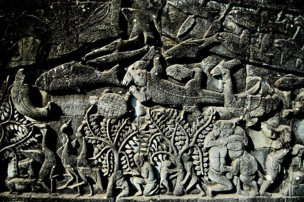 This BAS RELIEF is from the the Bayon temple in Angkor Thom city, part of the Angkor complex in Siem Reap Cambodia that includes the world's largest single religious monument, the breathtaking Angkor Wat. <br /> <br /> The Bayon temple is surrounded by two long walls with an extraordinary collection of bas-relief scenes with over 11,000 carved figures depicting historical events. The Bayon is a Buddhist temple but it incorporates elements of Hindu cosmology and represents the intersection of heaven and earth and is located in the exact center of Angkor Thom city.<br /> <br /> Angkor Thom is the last and most enduring city of the Khmer empire. Built as a square with sides that run exactly north to south and east to west by King Jayavarman VII, Angkor Thom is almost 4 sq miles or 10 sq km on the right bank of the Siem Reap River, a tributary of Tonle Sap Lake.<br /> <br /> It has been featured in many book, films and video games of pop culture most notably in the Angelina Jolie film, Lara Croft: Tomb Raider.