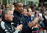 Photo: Paul Greenwood.<br />Accrington Stanley v Macclesfield Town. Coca Cola League 2. 28/04/2007.<br />Ex England player and Macclesfield manager Paul Ince joins in the minutes applause for Alan Ball