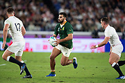 Damian de Allende of South Africa runs with the ball during the Rugby World Cup  final match between England and South Africa at the International Stadium ,  Saturday, Nov. 2, 2019, in Yokohama, Japan. South Africa defeated England 32-12. (Florencia Tan Jun/ESPA-Image of Sport)