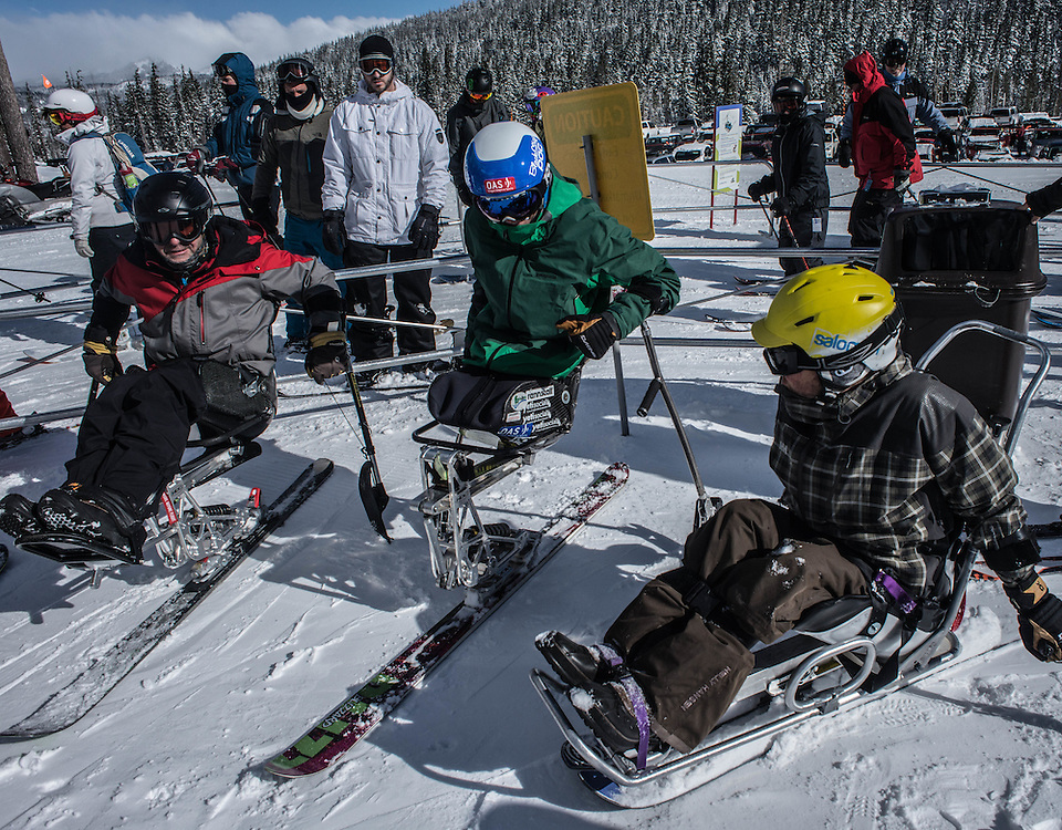 Ravi hangs out with other OAS riders while waiting for the next chairlift.