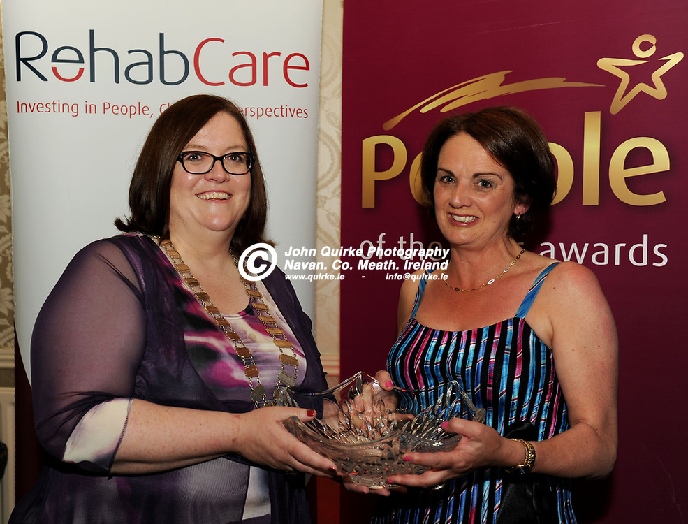 21-09-12. Rehab Meath People of the Year Awards 2012 at the Headfort Arms Hotel, Kells.<br /> Niamh McGowan, Cathoirleach, Meath County Council presenting the Rehab Overall Meath Person of the Year Award to Theresa Olohan, Kells founder of the Special Hands Group.<br /> Photo: John Quirke / www.quirke.ie<br /> ©John Quirke Photography, Unit 17, Blackcastle Shopping Cte. Navan. Co. Meath. 046-9079044 / 087-257945.