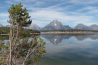 Mount Moran reflected in still waters of Jackson Lake, Grand Teton National Park Wyoming