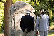 Civil war descendants view names on a memorial marker during a service at Elmwood Cemetery to mark Confederate Memorial Day May 2, 2015 in Columbia, SC. Confederate Memorial Day is a official state holiday in South Carolina and honors those that served during the Civil War.
