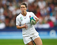 5th September 2010, Twickenham Stoop, London, England: Katherine Merchant of England on the ball during the IRB Women's Rugby World Cup final between England and New Zealand Black Ferns. New Zealand won 13-10, capturing the trophy for the 4th time.  (Photo by Andrew Tobin www.slikimages.com)