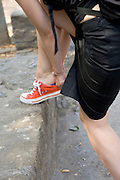 young female tourist adjusting her shoe