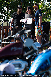 Brad Gregory gets an award from Pat Patterson on stage at Pat's Sportster Showdown Bike Show presented by Led Sled and Biltwell at the Buffalo Chip during the 78th annual Sturgis Motorcycle Rally. Sturgis, SD. USA. Tuesday August 7, 2018. Photography ©2018 Michael Lichter.
