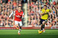 Arsenal's Jack Wilshere (l) makes a break during Barclays Premier League , Arsenal v Sunderland at the Emirates Stadium in London, England on Saturday 22nd Feb 2014.<br /> pic by John Fletcher, Andrew Orchard sports photography.