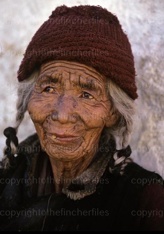Old lady with lined face seen in Leh, Ladakh, India. Photo by Jayne Fincher
