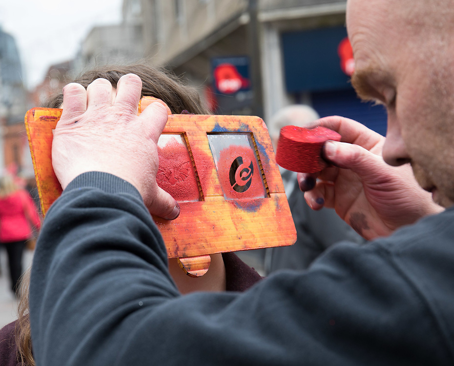 A Scarlets fan having some face paint applied<br /> <br /> Photographer Simon King/Replay Images<br /> <br /> Guinness PRO14 Round 21 - Dragons v Scarlets - Saturday 28th April 2018 - Principality Stadium - Cardiff<br /> <br /> World Copyright © Replay Images . All rights reserved. info@replayimages.co.uk - http://replayimages.co.uk