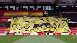 Stewards unfurl a banner in the stands before the FA Cup quarter final match at Vicarage Road, Watford.