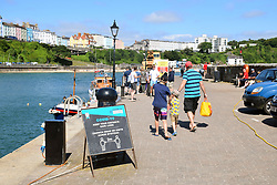 Tenby harbour, Pembrokeshire, South Wales July 2021 - Covid social distancing sign