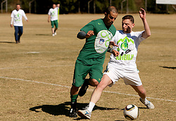 Uros Stanic of NZS vs Jernej Suhadolnik during the friendly match between Slovenian football journalists and officials of Slovenian football federation at  Hyde Park High School Stadium on June 16, 2010 in Johannesburg, South Africa.  (Photo by Vid Ponikvar / Sportida)