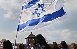 May 2, 2019 - Oswiecim, Poland - Participants of the March seen with the flags of Israel. The annual march is part of the educational program. Jewish students from all over the world come to Poland and study the remains of the Holocaust. Participants march in silence, three kilometers from Auschwitz I to Auschwitz II Birkenau, the largest Nazi complex of concentration camps built during World War II. (Credit Image: © Damian Klamka/ZUMA Wire)