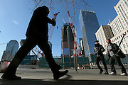PHOTO PETER PEREIRA/4SEE<br /> <br /> The new World Trade Center tower can be seen being constructed in the background as New Yorkers walk up Church St.  New Yorkers deal with the 10th anniversary of September 11, 2001 in different ways.