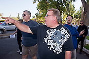 Nov. 9, 2009 -- PHOENIX, AZ: A member of the public who is opposed to a UFCW strike against Fry's and Safeway, shouts at union members walking into the UFCW Local 99 union hall in Phoenix Monday. Members of the United Food and Commercial Workers Union (UFCW) Local 99, based in Phoenix, AZ, is expected to go on strike against Fry's and Safeway grocery stores in Arizona on Friday, Nov. 13. The key sticking point in negotiations, which have broken down, is health care. Currently union members get health coverage for free, the grocery chains want to charge $5.00 per month. The stores have started hiring non-union replacement workers In anticipation of the strike. Unemployment in Arizona is around 10 percent and many union members have now come out against a strike fearing they could lose their jobs.    Photo by Jack Kurtz