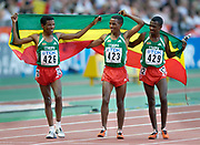 Haile Gebrsellasie (426), Kenenisa Bekele (423) and Sileshi Sihine (429) take a victory lap after they swept the first three places in the 10,000 meters in the IAAF World Championships in Athletics at Stade de France on Sunday, Aug, 24, 2003.