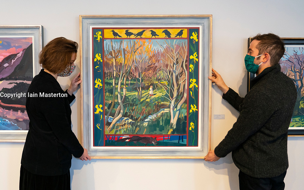 """Edinburgh, Scotland, UK. 28 October 2020. Lachlan Goudie's exhibition Once Upon A Time, inspired by fairy-tales and his experiences during lockdown, runs at The Scottish Gallery in Edinburgh from 28th October – 25th November. Pictured; gallery assistants hang painting """"Fairy Tales"""". Iain Masterton/Alamy Live News"""