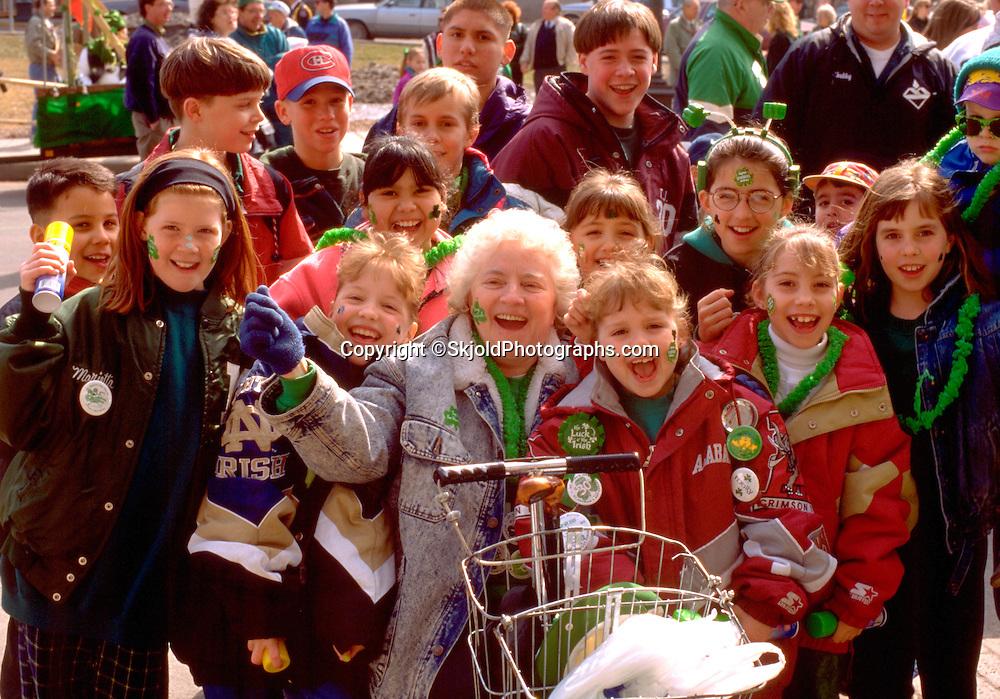 Disabled grandma and grand kids at St Patricks parade age 65 and  5 through 13.  St Paul Minnesota USA