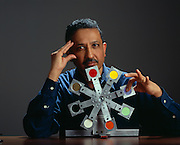 Dr Srinivasan; Mandayam Srinivasan founder of the MIT Touch Lab with a wheel of color chips of various thickness that measures the subjects sensivity to the thickness of various swatches.