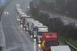 © Licensed to London News Pictures. 21/12/2020. Folkestone, UK. Freight traffic on the M20 at Junction 12 in Folkestone,Kent. A major police operation is underway in Kent as Operation Stack is implemented on the M20 due to the Port of Dover and Channel Tunnel having to close in response to France closing its borders to the UK. All freight and passenger traffic have been banned for 48 hours due to the new mutant strain of the Coronavirus in England. traffic. Photo credit:Grant Falvey/LNP