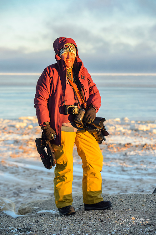 Photographer Lynn Hackett along the Hudson Bay coast, Churchill, Manitoba, Canada