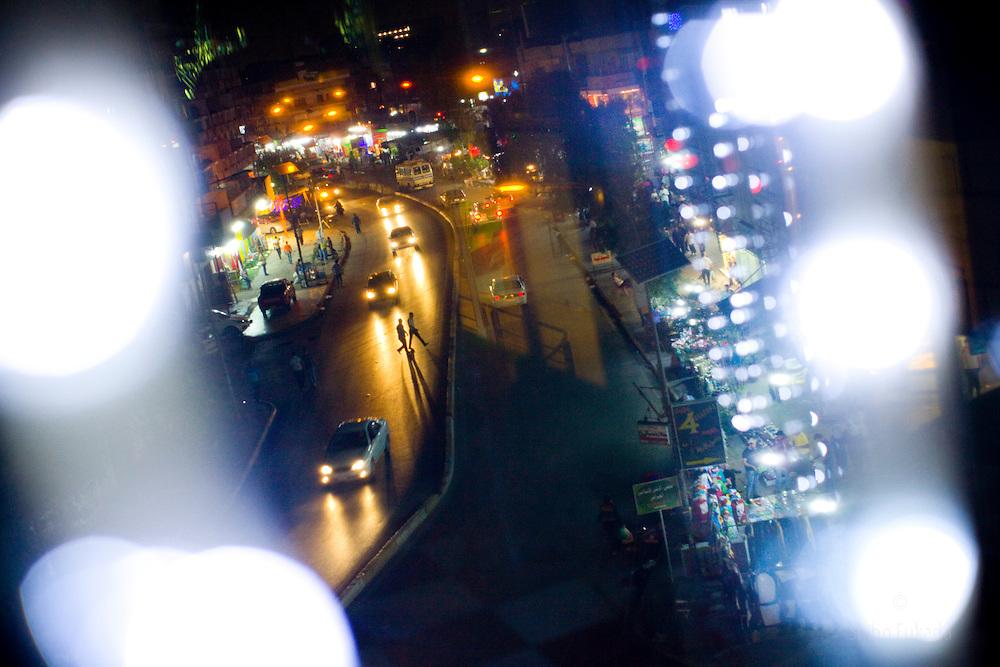 Street view at night in Karadah district, Baghdad in Iraq.