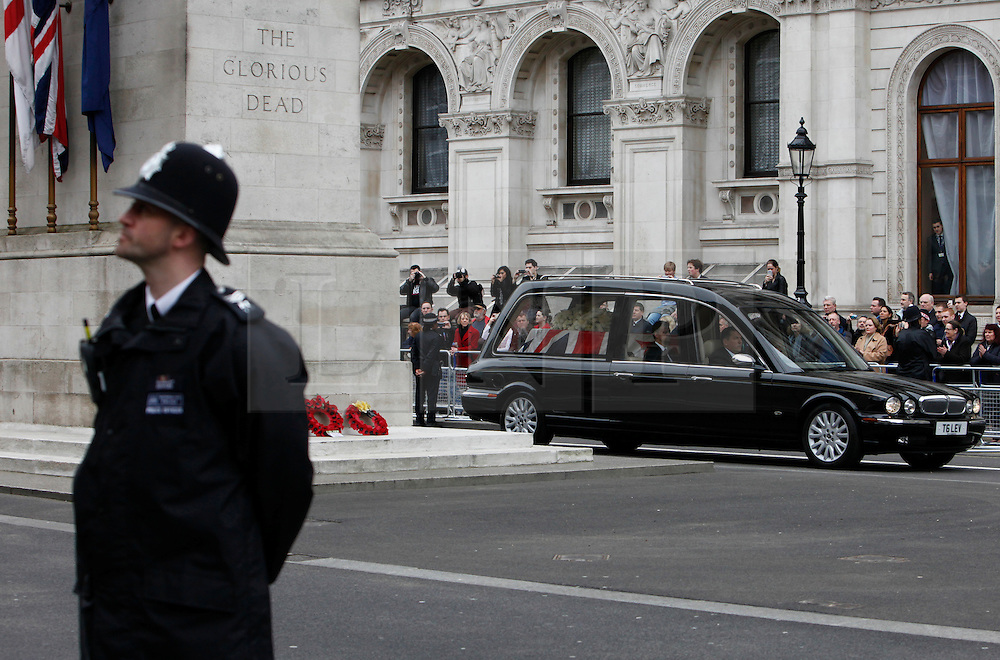 © Licensed to London News Pictures. 17/04/2013. London, U.K..the hearse carrying margaret thatcher coffin passes the cenotaph in whitehall during the ceremonial Funeral with military honours of Baroness Thatcher , the first female Prime Minister of United Kingdom (today 17/4/2013), who died last week of a stroke..Photo credit : Rich Bowen/LNP