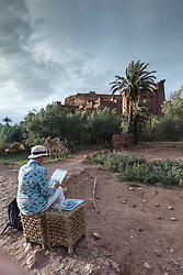 Artist painting watercolor of ancient ksar (old city) of Aït Benhaddou, Morocco