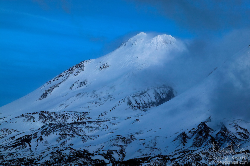 Storm clouds surround the summit of Mount Shasta, a 14,179-foot (4,322 m) volcano in Siskyou County, California at twilight. Shasta is the second-highest peak in the Cascade Range, and the largest by volume.