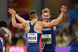 Mihail Dudas of Serbia high-fives Kevin Mayer of France - Mandatory byline: Patrick Khachfe/JMP - 07966 386802 - 11/08/2017 - ATHLETICS - London Stadium - London, England - Men's 1500m Semi-Final - IAAF World Championships