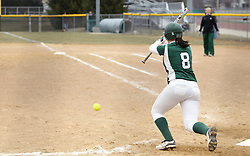 30 March 2013:  Emma Clark bunts during an NCAA Division III women's softball game between the DePauw Tigers and the Illinois Wesleyan Titans in Bloomington IL