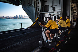 SAN DIEGO (May 22, 2017) Sailors conduct their bi-annual Physical Readiness Test (PRT) on stationary bikes in the hangar bay of the aircraft carrier USS Theodore Roosevelt (CVN 71). The ship is moored pier side in her homeport of San Diego after completing Tailored Ship's Training Availability and Final Evaluation Problem. (U.S. Navy photo by Mass Communication Specialist Seaman Bill M. Sanders/Released)170522-N-TV230-105<br /> Join the conversation:<br /> http://www.navy.mil/viewGallery.asp<br /> http://www.facebook.com/USNavy<br /> http://www.twitter.com/USNavy<br /> http://navylive.dodlive.mil<br /> http://pinterest.com<br /> https://plus.google.com