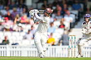 Sam Curran of Surrey hits the ball over the boundary for six runs during the Specsavers County Champ Div 1 match between Surrey County Cricket Club and Kent County Cricket Club at the Kia Oval, Kennington, United Kingdom on 7 July 2019.