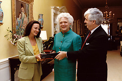 First lady Barbara Bush, center, receives a TeleCaption decoding device from John E.D. Ball, President of the National Captioning Institute (NCI), right, and actress Marlee Matlin, Chairperson of Friends of NCI, left, at the White House in Washington, DC, USA, on June 19, 1990. The devices allow hearing impaired and other viewers to see captions on their televisions. Photo by Carol T. Powers / White House via CNP/ABACAPRESS.COM