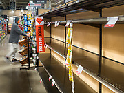"""14 MARCH 2020 - DES MOINES, IOWA: The toilet paper section of a Hy-Vee grocery store in downtown Des Moines. The store has been out of toilet paper and hand sanitizer for two days because of panic buying caused by the Coronavirus. The Governor of Iowa announced Saturday night that the Coronavirus in Iowa had entered the """"community spread"""" phase when a person in Dallas County, in the Des Moines metropolitan area, tested positive for Coronavirus. This is the first case reported in the Des Moines area. As of Sunday morning, Iowa was reporting 18 people tested positive for Coronavirus.                   PHOTO BY JACK KURTZ"""