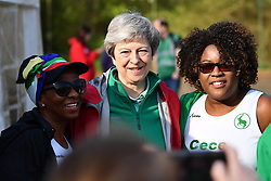 © Licensed to London News Pictures. 19/04/2019. Maidenhead, UK. Prime Minister THERESA MAY helps out at the Maidenhead Easter 10 run in her constituency of Maidenhead in Berkshire worth get husband PHILIP MAY. Parliament currently on Easter recess after an extension to Article 50 was granted by the EU. Photo credit: Ben Cawthra/LNP