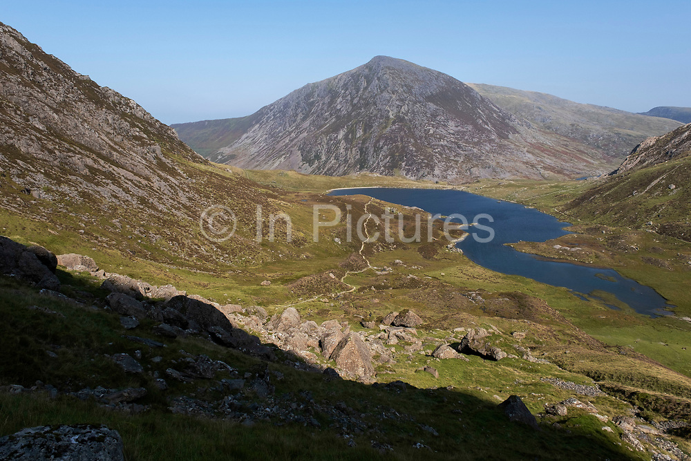 Landscape view in the mountains surrounding  Llyn Idwal in the Cwm Idwal National Nature Reserve on 17th September 2020 in Pont Pen-y-benglog, Snowdonia, Wales, United Kingdom. Llyn Idwal is a small lake that lies within Cwm Idwal in the Glyderau mountains of Snowdonia. It is named after Prince Idwal Foel, a grandson of Rhodri Mawr, one of the ancient Kings of Wales.