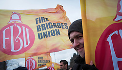 © Licensed to London News Pictures. 08/02/2014. Middlesbrough, UK.  Members and supporters of the Fire Brigade Union gather in the centre of Middlesbrough during a rally to voice their opposition to proposed cuts outlined by Cleveland Fire Authority. The FBU say that the proposed cuts would lead to 130 job losses, including a quarter of the brigade's firefighters, less specialised equipment and slower response times. Photo credit : Ian Forsyth/LNP
