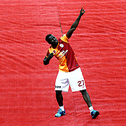 Galatasaray's Emmanuel Eboue celebrate with the trophy after their Turkish Super League soccer match against Trabzonspor at Turk Telekom Arena stadium May 18, 2013.Galatasaray won the Turkish league title for the 19th time. Photo by Aykut AKICI/TURKPIX
