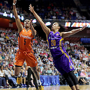 UNCASVILLE, CONNECTICUT- JULY 15:  Jasmine Thomas #5 of the Connecticut Sun scores two points as she shoot past Kristi Toliver #20 of the Los Angeles Sparks  during the Los Angeles Sparks Vs Connecticut Sun, WNBA regular season game at Mohegan Sun Arena on July 15, 2016 in Uncasville, Connecticut. (Photo by Tim Clayton/Corbis via Getty Images)