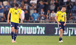 Scotland's Scott McKenna (left) and Kieran Tierney appear dejected during the UEFA Nations League Group C1 match at the Sammy Ofer Stadium, Haifa.